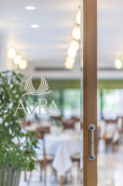 Avra logo on restaurant entrance door