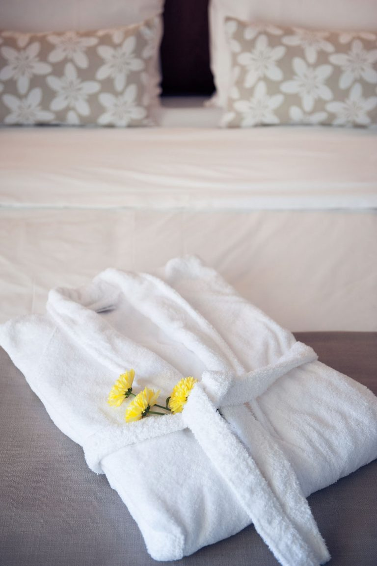 Bathrobe on top of bed