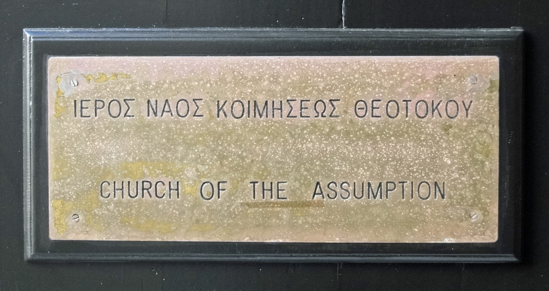 Close up of the sign for the Church of the Assumption
